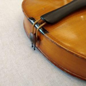 Fijación inferior del violín - Esteve Enmarcadores